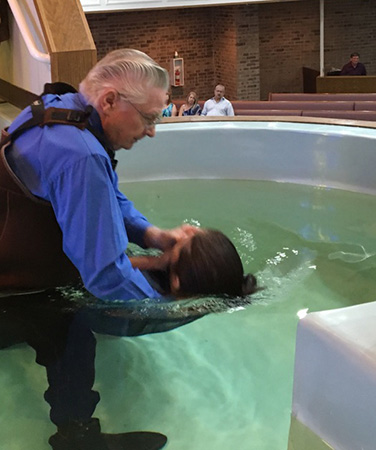 An evangelist of the church Christ built upon the immovable rock of his own divinity baptizes a believing, repentant person according to God's established mode, that is, by immersion, and his stated purpose of for the forgiveness of sin.