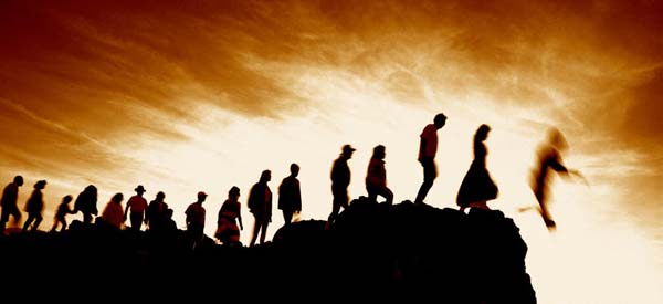 In this graphic, a single file of people in silhouette approach the edge of a cliff and fall downward toward the place of eternal punishment, an illustation for the subject This Way to Heaven, in iglesia-de-cristo.com.