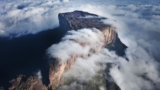 "This photograph of a massive, flat promontory thrusting above mists and clouds is selected to illustrate the subject We Invite You to Learn About the Church Christ Built, which he said he would build ""on this rock,"" that rock being his own divine being, for he is the chief cornerstone of the foundation of the church."